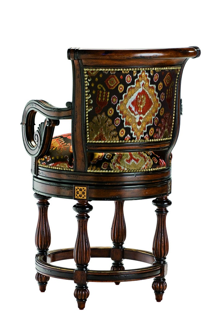 Antigua Counter Stool shown with:Tight seat and backOld World Hazelnut finishEbony Paint finish trimZanzibar nailhead frame trim