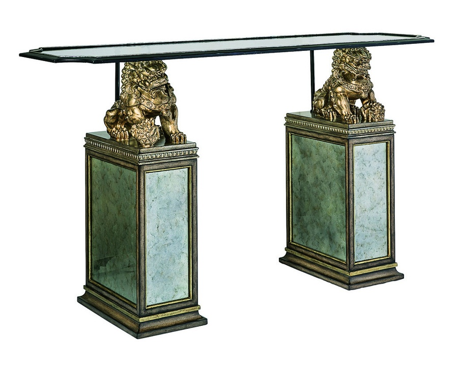 Cross Channel Console shown with:Sandalwood finish withAntique Silver Leaf trim on basesAntique Silver finish on foo dogsMetal frame in Blackened Iron finish withAntique Silver Leaf finish trimClear glass with beveled edge topGunmetal glass panel insets