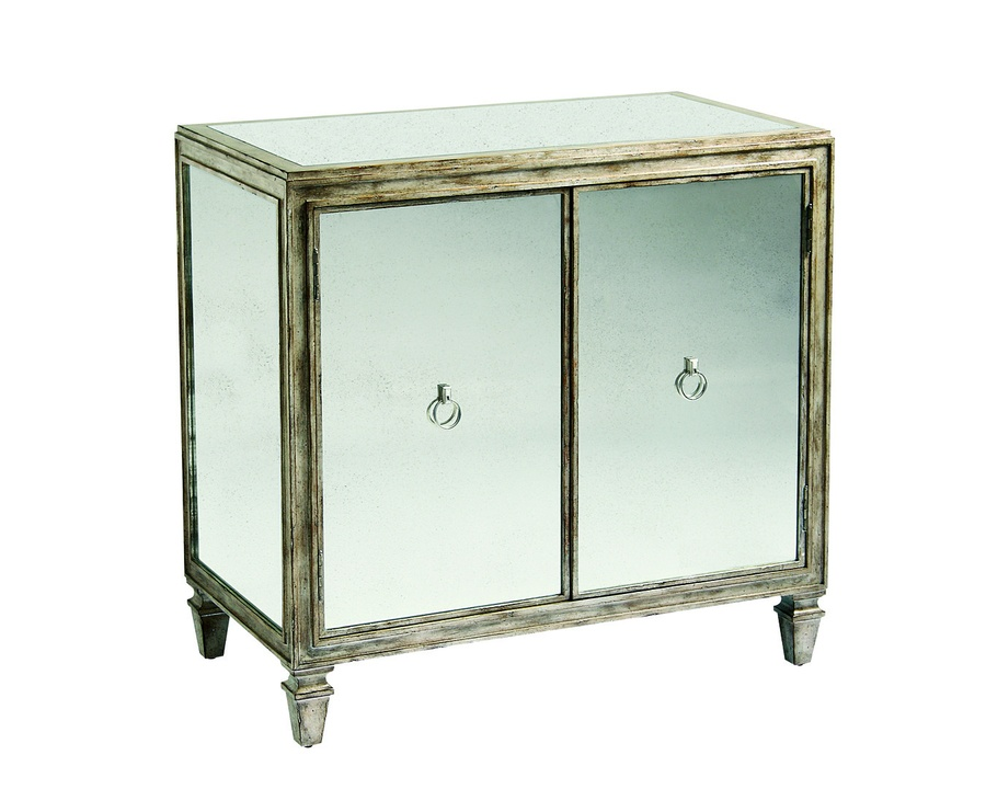 Design Folio Nightstand shown with:Silver Cloud finishAntique Mirror on doors and side panelsAntique Mirror topTransitional LegCrystal Ring decorative hardware in Polished Nickel finish