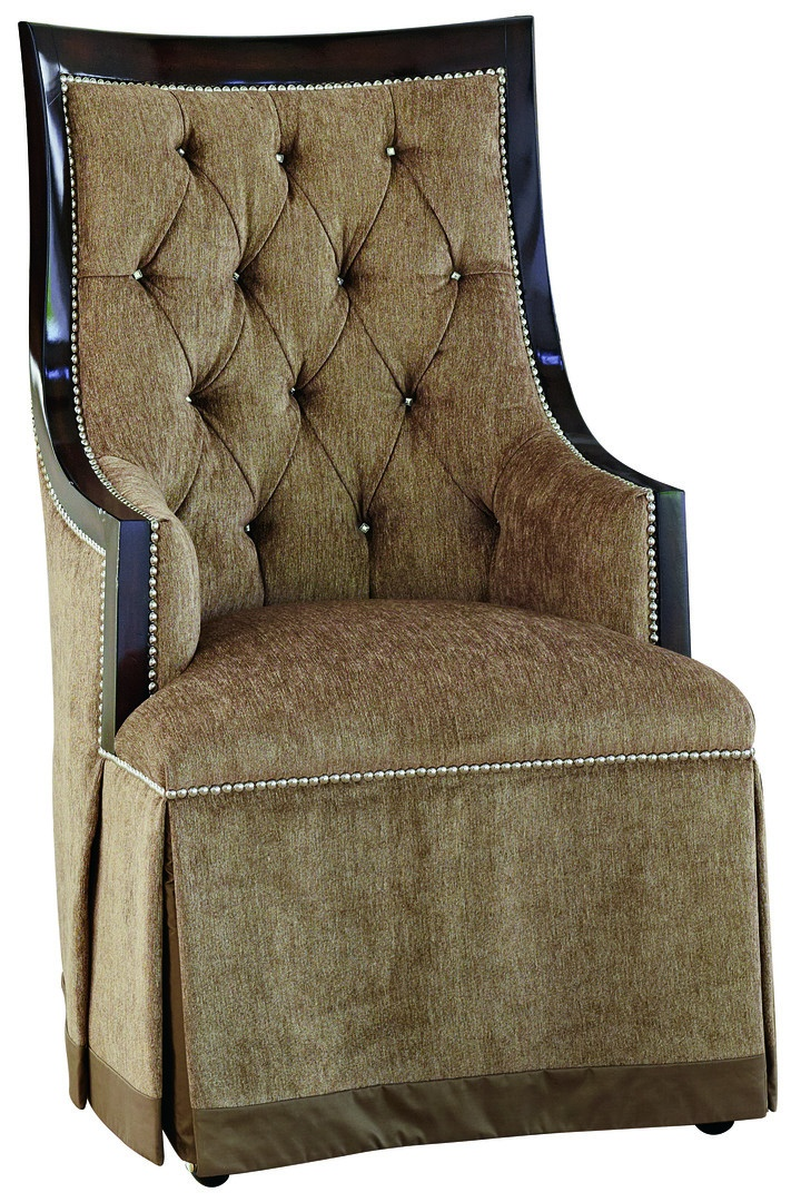 """Jolie ArmChair shown with:Tight seatButton tufted backDeep skirt with split back and button detailContrast 2½"""" band at bottom of skirtContemporary HavanafinishSilvernaihead frame trimCasters"""