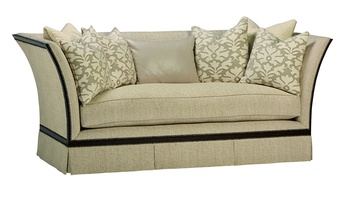 Riley Sofa shown with: Boxed bench seat Deep skirtHavana finishAntique Brass nailhead frame trim