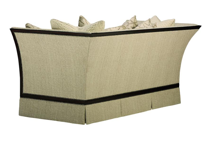 Riley Sofa shown with: Boxed bench seat Deep skirtHavana finishAntique Brass nailhead frame trim