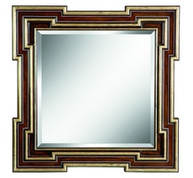 Rivoli Mirrorshown with:Contemporary HavanafinishBurnished Silver Leaf finish trimSilver stud detail along panel insetClear mirror with beveled edge