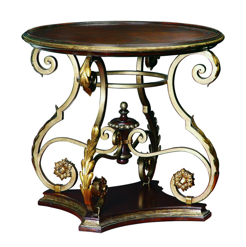 Seville Round End Table shown with:Old World Briar finishAged Gold Leaf finish trimDecorative metalwork in Aged Metal withAged Gold Leaf finish trim