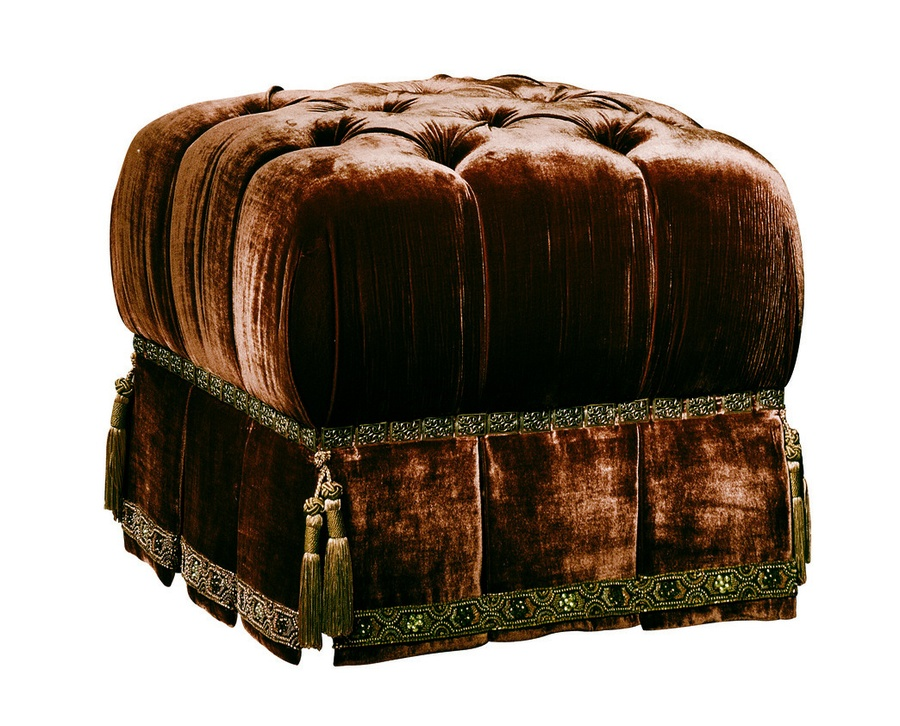Tara Ottoman shown with:Button tufted seatDeep box pleated skirtDecorative tape band at bottom of skirtLaced Link nailhead frame trimAccessory tassel ties