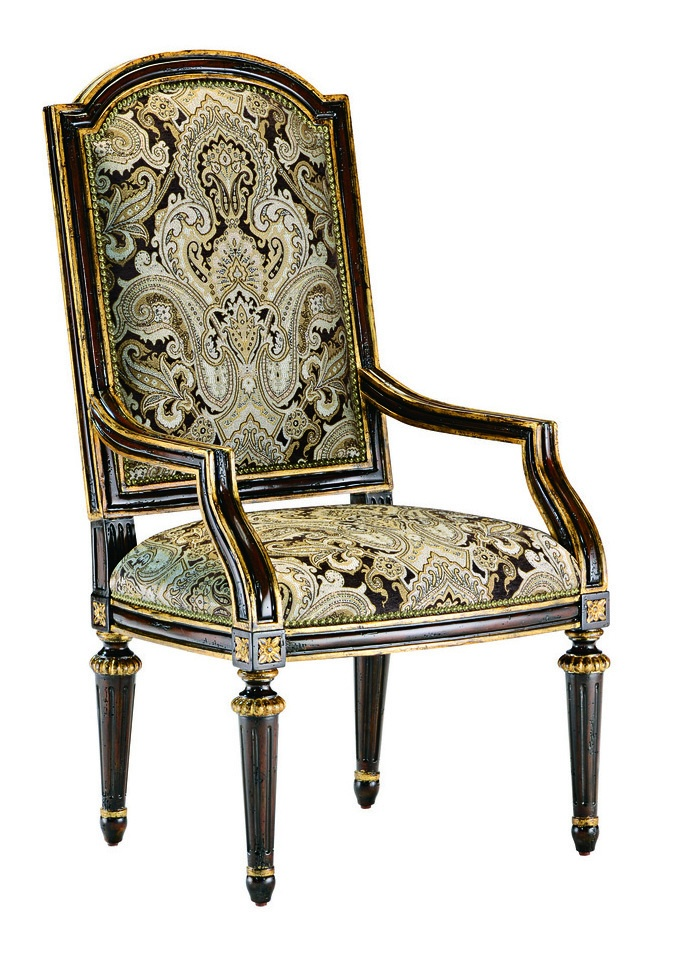 Trianon Court ArmChairshown with:Tight seat and backOld World Havana finishAged Gold Leaf finish trimMetal back inset in Aged Metal finish withAged Gold Leaf finish trimZanzibar nailhead frame trim