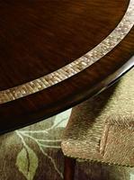Bolero Dining Tableshown with:Havanafinishwith Ebony paint trimPolished Honey shell decorative top inlayDecorative metalwork in Medici finish withVenetian Gold Leaf finish trim