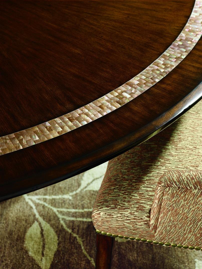 Bolero Dining Tableshown with:Havanafinishwith Ebony paint trimDecorative Walnut top inlayDecorative metalwork in Medici finish withVenetian Gold Leaf finish trim