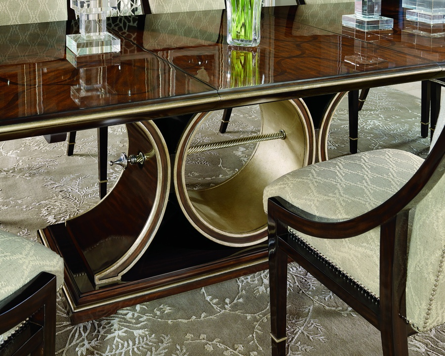 Bolero Dining Table shown with:Bombay finish on base withDeco Silver Leaf finish trimTop in Contemporary Havana finishContrast interior circle in Deco Silver finishDecorative twisted rod in Polished Nickel finish