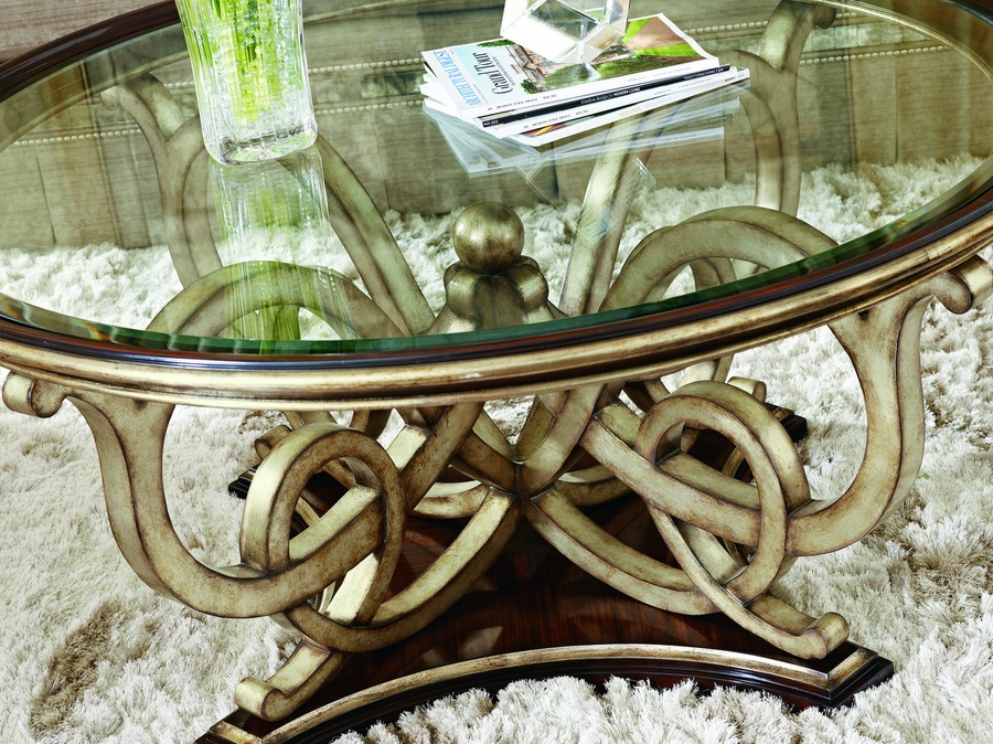 Bossa Nova Cocktail Table shown with:Contemporary Havana finish Versailles Leaf finish trimDecorative metalwork with ball detail in Versailles finish Clear inset glass with beveled edge