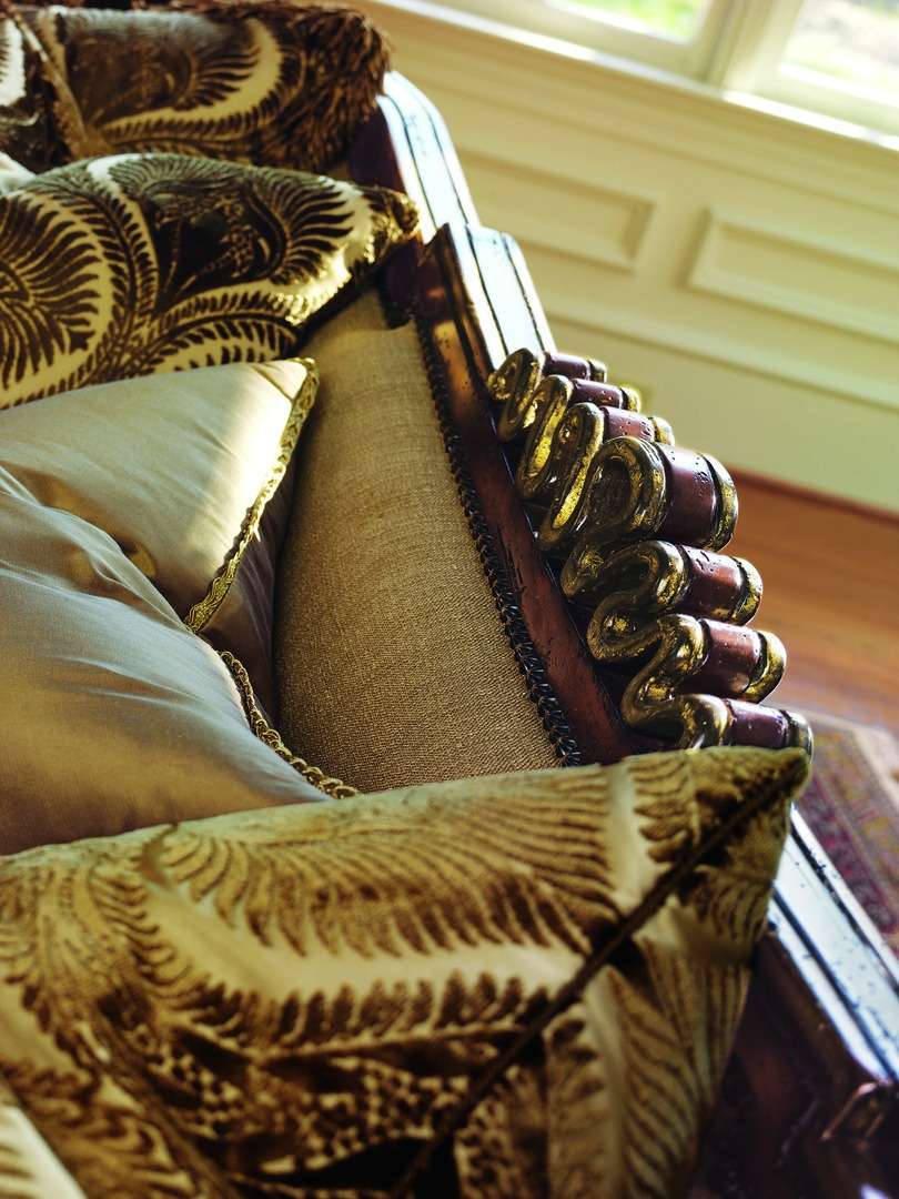 Chantelle Sofa shown with: Boxed bench seatWaterfall skirt with built-in sides, back, and button detailAccessory tassel tiesOld World Hazelnut finishAged Gold Leaf finish trimBronze Star nailhead frame trim