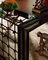 Cross Channel Desk shown with:Sandalwood finishTruffle paint finish trimDecorative metalwork in Blackened Iron finish withAntique Silver Leaf finish trimTop center leather section in Havana finish