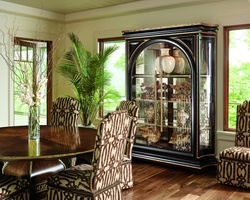 Cross Channel Display Cabinet shown with:Nochefinishwith metal leaffinish trimContrast interior in Havana finishMetal shelf frame in Antique MedicifinishMedici Nickel hardware Available in a selection of finishes and finish trims
