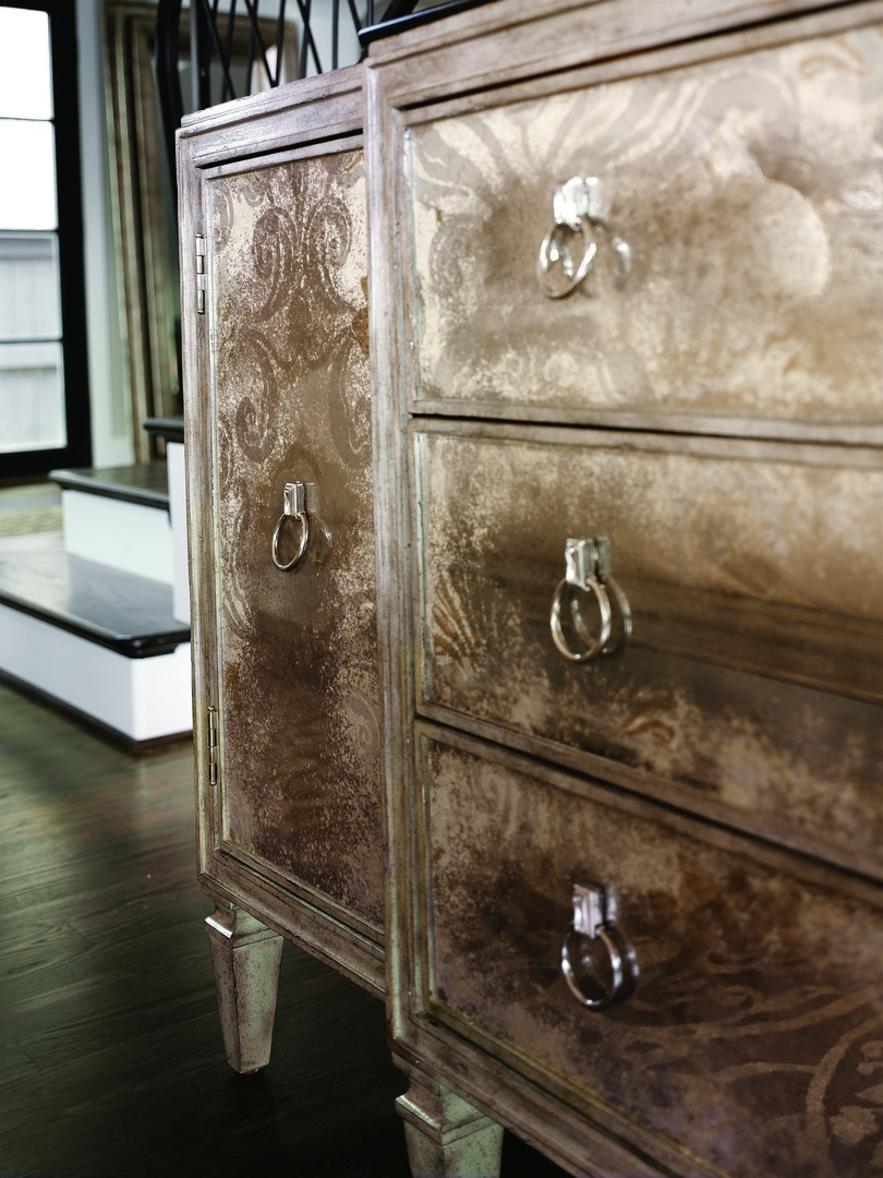 Design Folio Credenza/Dresser shown with:Silver Cloud finishTransparent Antique Mirror over fabric on doors, drawers,side panels, and topTransitional LegCrystal Ring decorative hardware in Polished Nickel finish