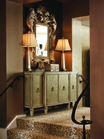 Design Folio Credenza/Dressershown with:Leatheron doorsandside panelsPolished Oatmeal Marble topTransitional LegPendant Pulldecorative hardware in Polished Nickel finish Available in selection of finishes and optional finish trims