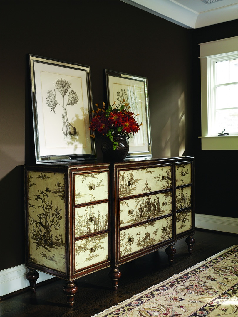 Design Folio Credenza/Dresser shown with:Old World Briar finish with metal leaf finish trimFabric on drawers and side panelsTraditional LegFlower Knob decorative hardware in Antique Nickel finish