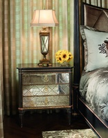 Ionia Nightstand shown with:Noche finishAged Venetian Gold Leaf finish trimRegency Glass panel insetsPolished Madeira Marble topPolished Brass hardwa
