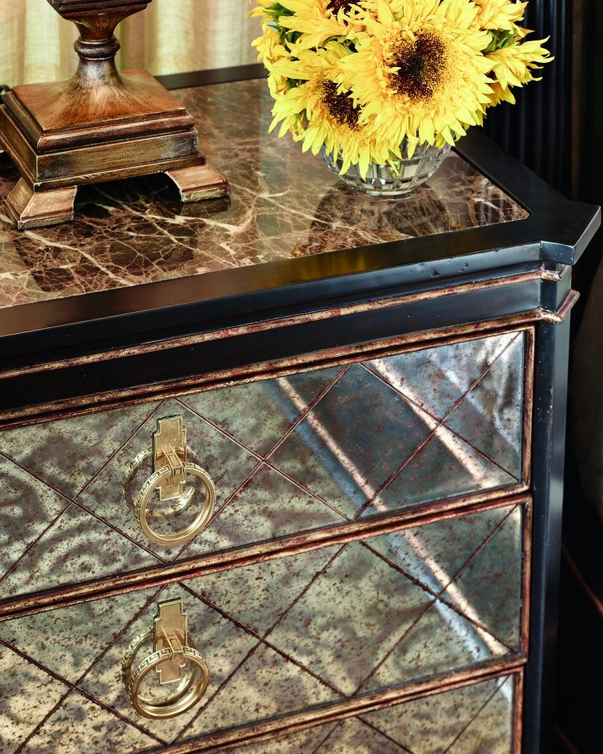 Ionia Nightstandshown with:NochefinishAged Venetian Gold Leaf finish trimRegency Glass panel insetsPolished Madeira Marble topPolished Brass hardware