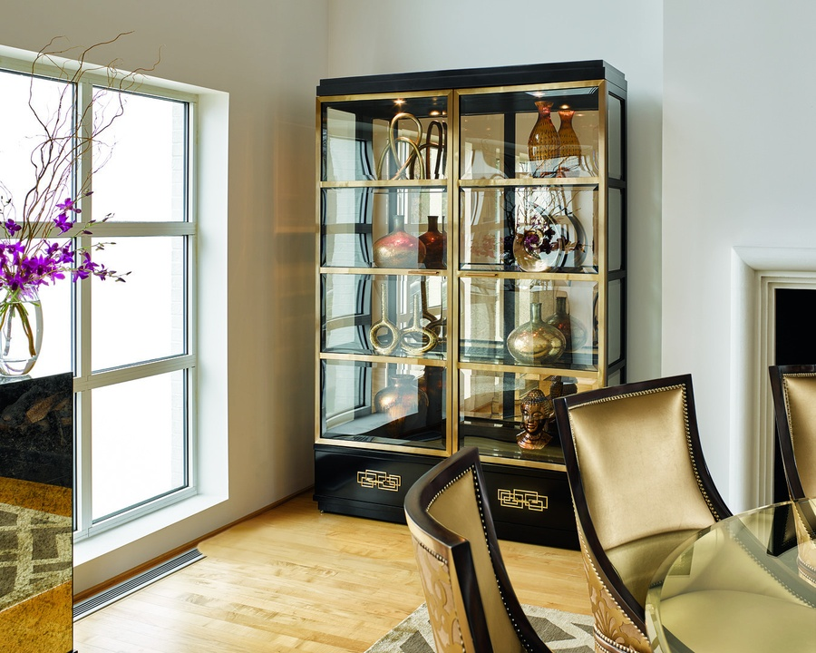 Lake Shore Drive Display Cabinet shown with:Bombay finishStainless Steel door framePolished Nickel hardwareClear Mirror back