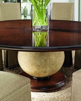 Malibu Dining Table shown with:Contemporary Havana finishBurnished Silver Leaf finish trimPolished Stone Camel sphere pedestal
