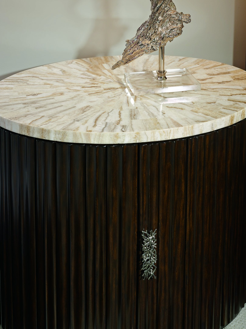 Malibu Oval Nightstand shown with:Bombay finishEbony paint finish trimPolished Crystal Stone Taupe topPolished Nickel hardware