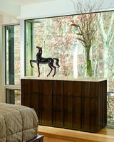 Malibu Dresser shown with:KonafinishEbony finishon plinth basePolished Crystal Stone Taupeontop