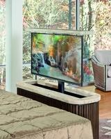 Malibu TV Console shown with:KonafinishEbony finish on plinth basePolishedCrystal Stone Beige topTV lift mechanism