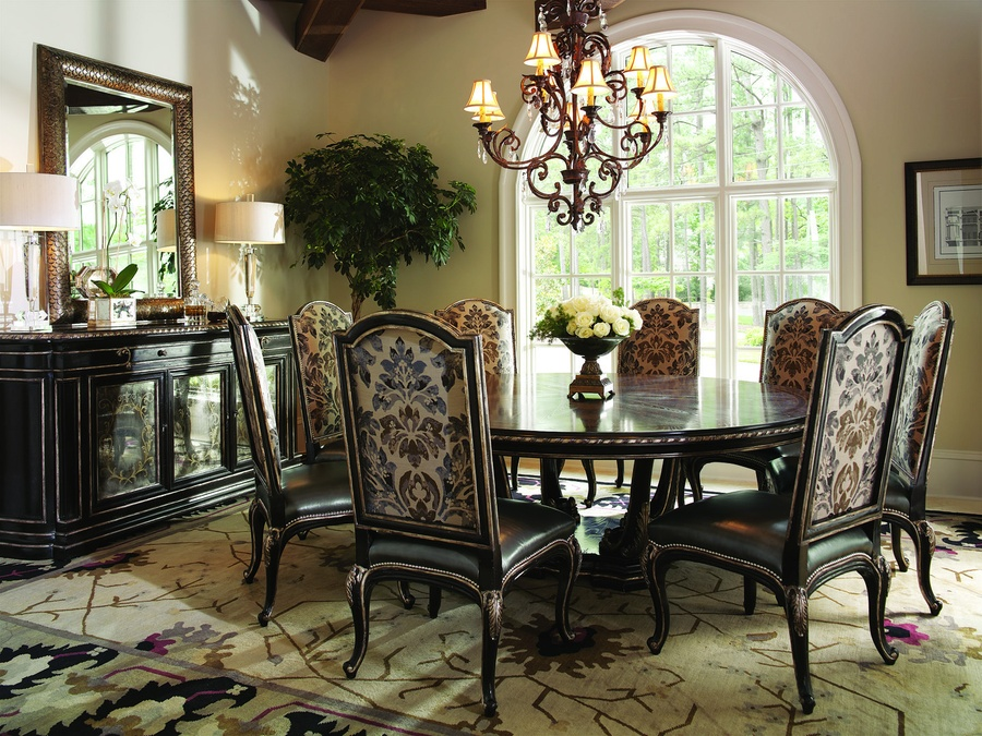 Piazza San Marco Dining Table shown with:Old World Sumatra finish withVersailles Leaf trim on baseBriar finish withVersailles leaf finish trim on top