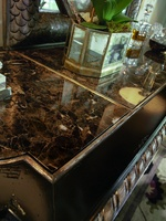 Piazza San Marco Credenza shown with:Old World Sumatra finishVersailles Leaf trimVenetian painted mirror with Silver Artwork on door facesPolished Maderia Marble on topAntique Nickel hardware