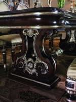 Piazza San Marco Dining Table shown with:Old World Orleans finish withVersaillesLeaf finish trim on baseBriar finish withVersailles Leaf finish trim on topDecorative metalwork in Aged Iron finish withVersailles Leaf finish trim