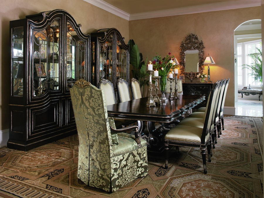 Piazza San Marco Dining Table shown with:Old World Orleans finish withVersailles Leaf finish trim on baseBriar finish withVersailles Leaf finish trim on topDecorative metalwork in Aged Iron finish withVersailles Leaf finish trim