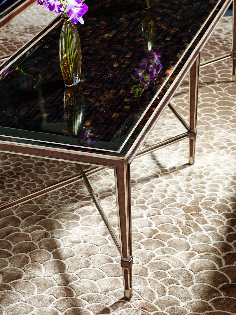Redondo Cocktail Table shown with:BronzefinishVersaillesLeaf finishtrimPolished Raven shell top and inset top frame