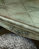 Rivoli Desk shown with:Silver Cloud finishScored diamond pattern veneer withSilver Mosaic shell inlay topAntique Nickel stylized swirl hardware