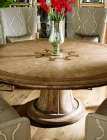 Rivoli Dining Table shown with:Heirloom Desert finishAged Silver Cloud Leaf finish trim