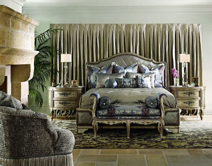 Rivoli Panel Bed shown with:Diamond quilted upholstered headboard, footboard, and side railsHeirloom DesertfinishAged Silver Cloud Leaf finish trimSilver Star nailhead frame trim