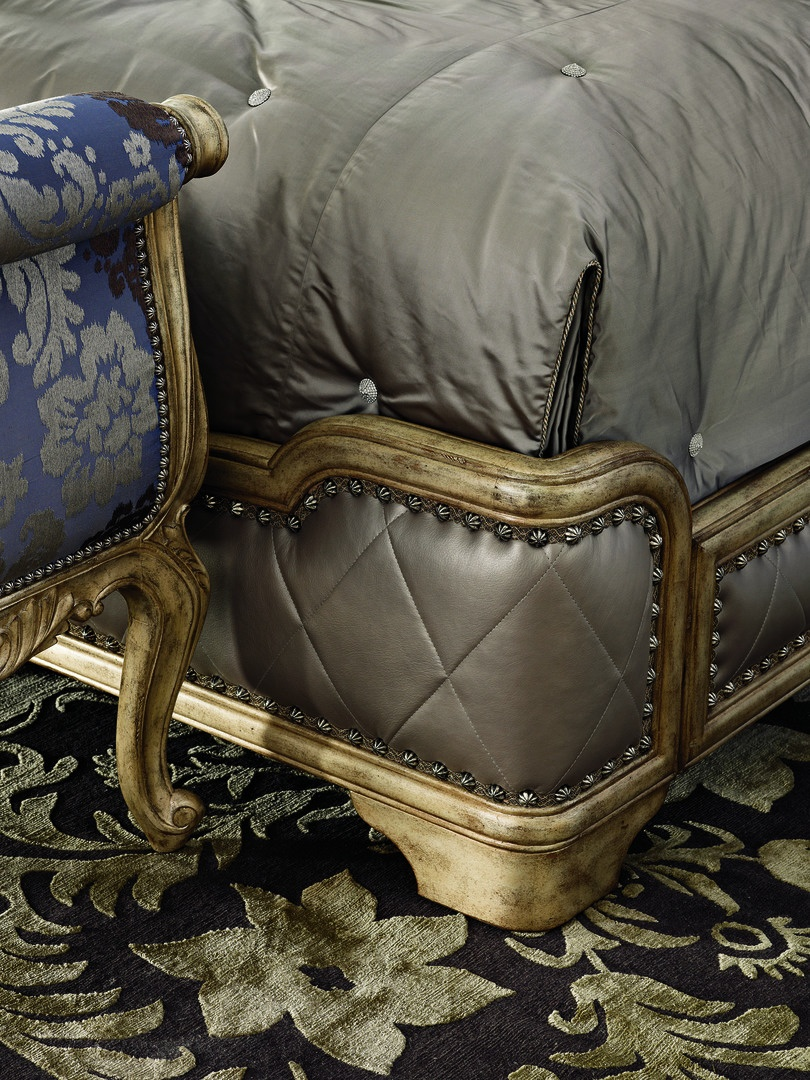 Rivoli Panel Bed shown with:Diamond quilted upholstered headboard, footboard, and side railsHeirloom Desert finishAged Silver Cloud Leaf finish trimSilver Star nailhead frame trim