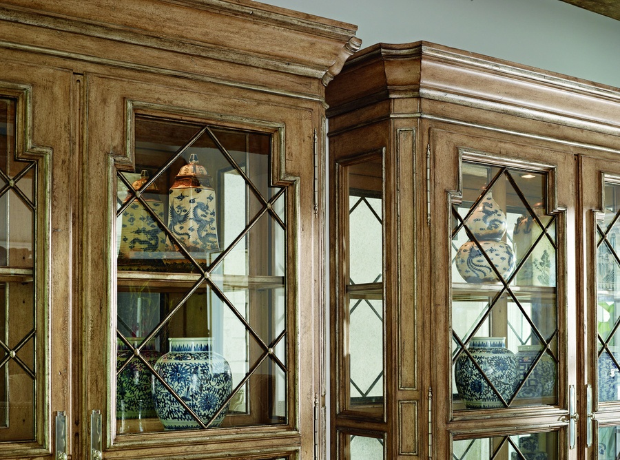Rivoli Display Cabinet shown with:Silver Cloud finishDecorative metalwork in a signature metal finishwithSilver CloudLeaf finish trimAntique Mirror backAntiqueNickel hardware