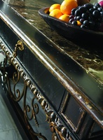 Seville Console shown with:Old World Vintage Noir finishAged Gold Leaf finish trimAged Gold Leaf finish trimDecorative metalwork in Antique Gold finishPolished Madeira Marble top