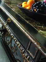 SevilleConsoleshown with:Old World Vintage NoirfinishAged GoldLeaf finish trimAged GoldLeaf finish trimDecorative metalwork inAntique GoldfinishPolished Madeira Marble top
