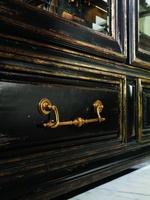 Seville Display Cabinet shown with:Old World Vintage Noir finishAged Gold Leaf finish trimAntique Brass hardware