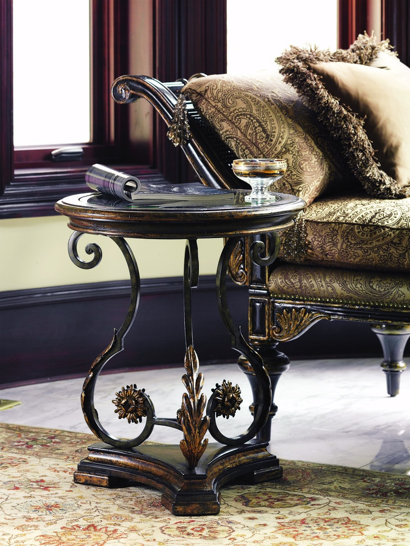 Seville Chairside Table shown with:Decorative metalwork in Bronze finish withAged Gold Leaf finish trimInset clear glass top with beveled edgeHardwood base available in choice of select woodfinishes and optional finish trims
