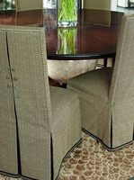 Sinatra Side Chair shown with:Tight seat and backDeep skirt with split back and button detailDecorative tape along bottom of skirtSilver nailhead frame trim