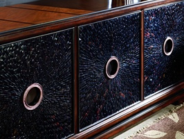 Sonoma Credenza shown with:Distressed Kona finish with Ebony Paint finish trimTextured Raven shell door faces withEbony Paint finish trimAntique Bronze hardware