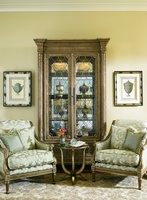 Trianon Court Display Cabinet shown with:Pompeii finishContrast interior in Old World Orleans finishDecorative metalwork in Deco Silver finishAntique Nickel hardware
