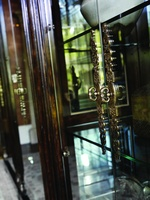 Villa Argenta Display Cabinet shown with:Old World Havana finishAged Gold Leaf finish trimDecorative metal grill in Aged Metal finish withAged Gold Leaf finish trimAntique Brass