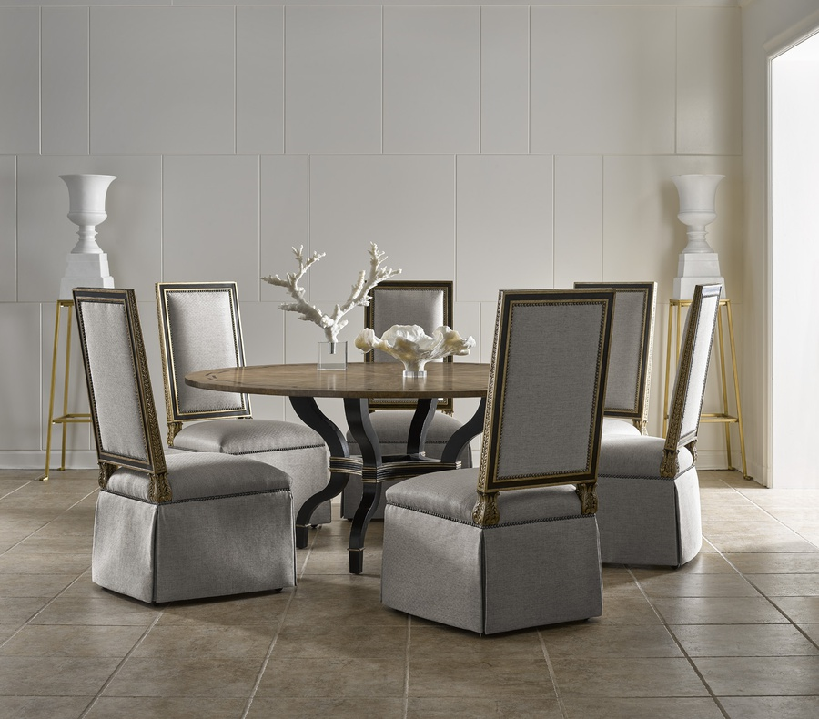 Arcadia Dining Table shown with:Cathedral White Ash top with ebonized inlay, available in any finishNoche finish on baseBronzed Silver Leaf finish trim