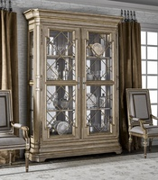 Arcadia Display Cabinet shown with:Dapple finishBurnished Silver Leaf finish trimDecorative Metalwork in Burnished Silver finishAntique Nickel hardwareClear Mirror back