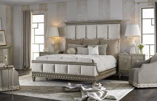 Arcadia Panel Bed shown with:Channeled upholstered headboardDapple finishBurnished Silver Leaf finish trimSmallGunmetalnailhead