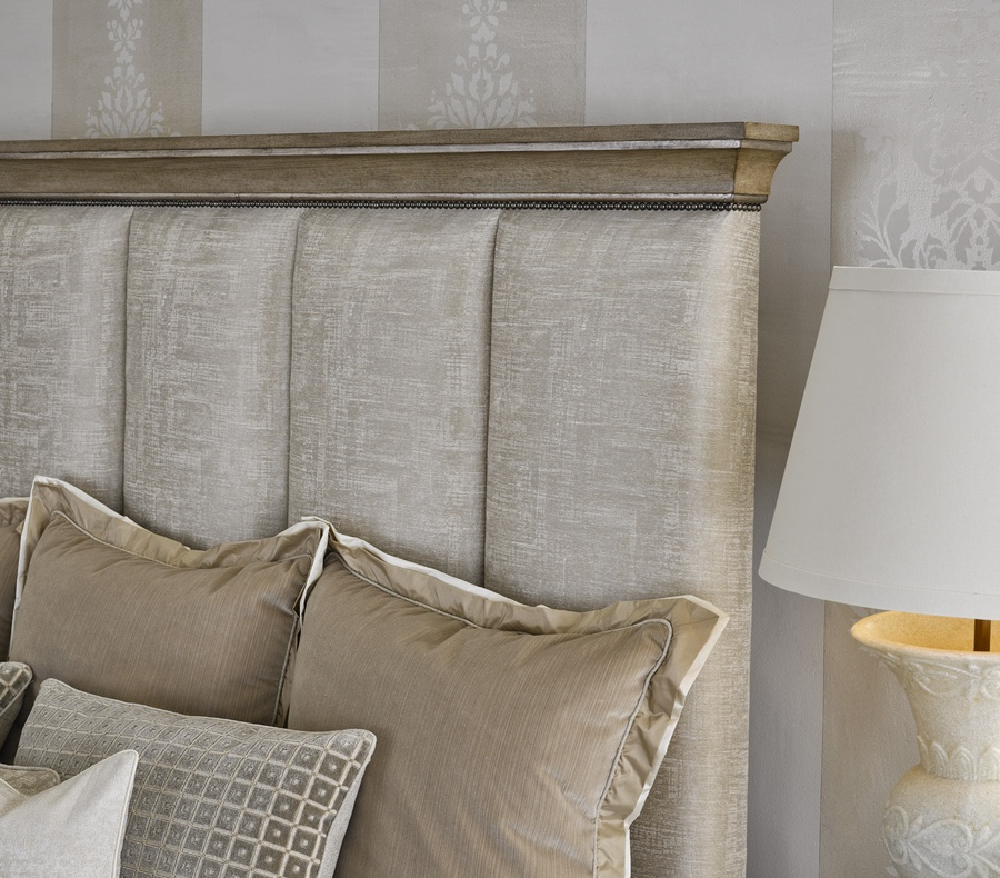 Arcadia Panel Bed shown with:Channeled upholstered headboardSaddle finishAged Medici Leaf finish trimSmall Antique Heritage nailhead spaced over fabric tape