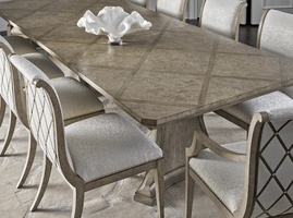"Arcadia Dining Table shown with:Dapple finishBurnished Silver Leaf finish trim24"" leaf"